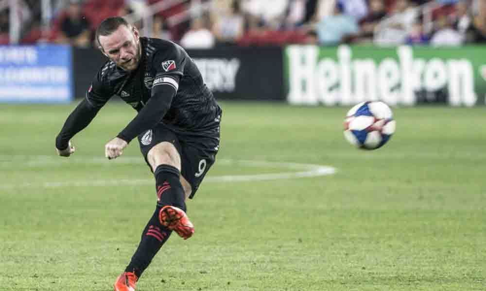 Rooney hits winning goal from inside his own half