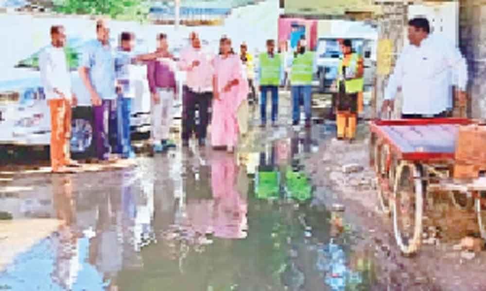 Corporator Alakunta Saraswathi points out squalor in colony