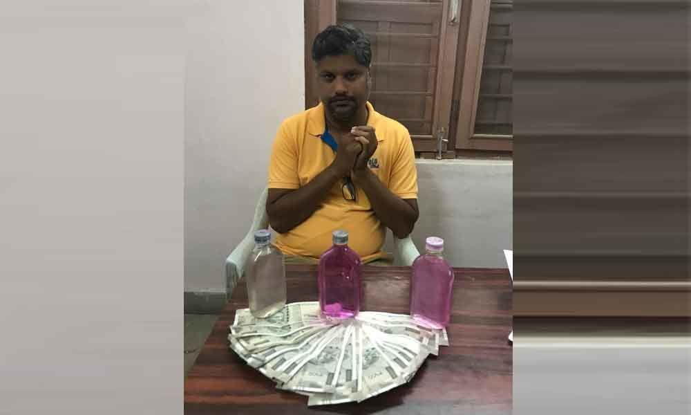 Two officials caught accepting bribe