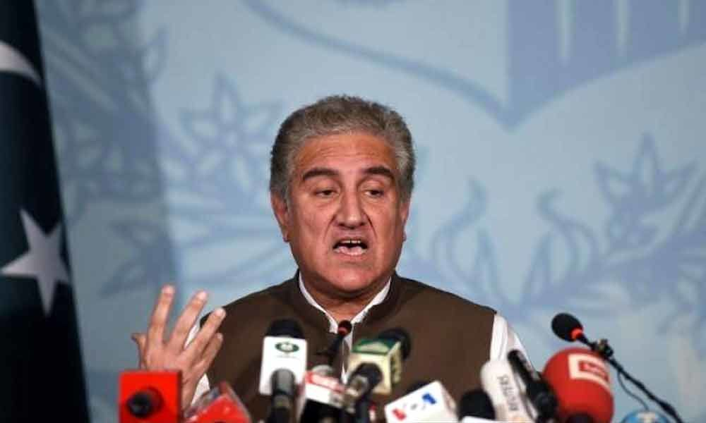 Pakistan foreign minister Shah Mehmood Qureshi heckled in London over media freedom