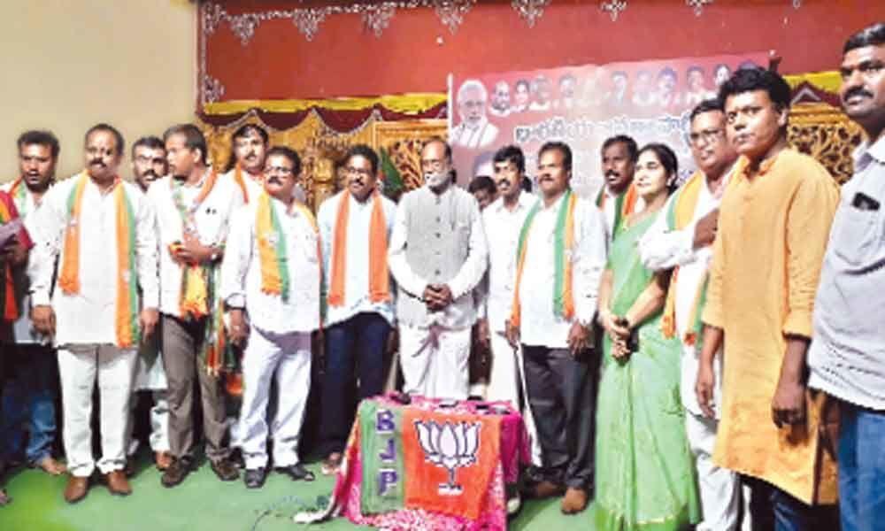 Several people take BJP membership