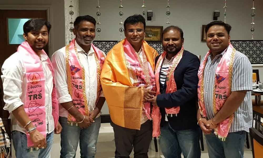 TRS NRIs felicitate party MLA in London