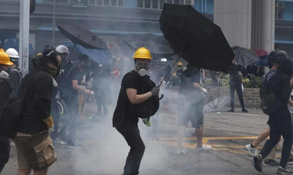 China warns Hong Kong protesters with slick military video