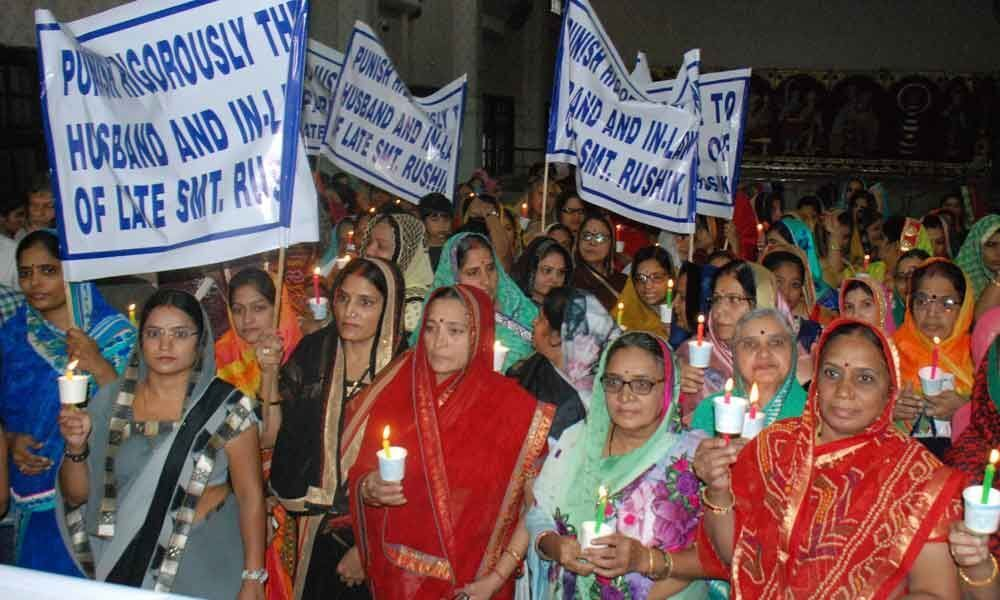 Candlelight march against dowry death