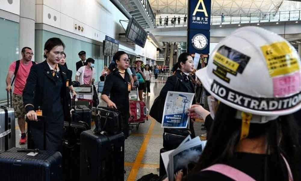 Amid protests, more than 100 flights cancelled in Hong Kong