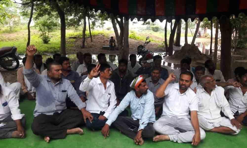 Farmers demand pattadar passbooks in Nizamabad