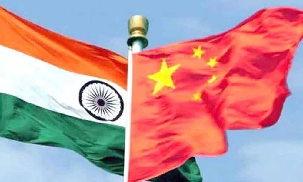 China promises to address India