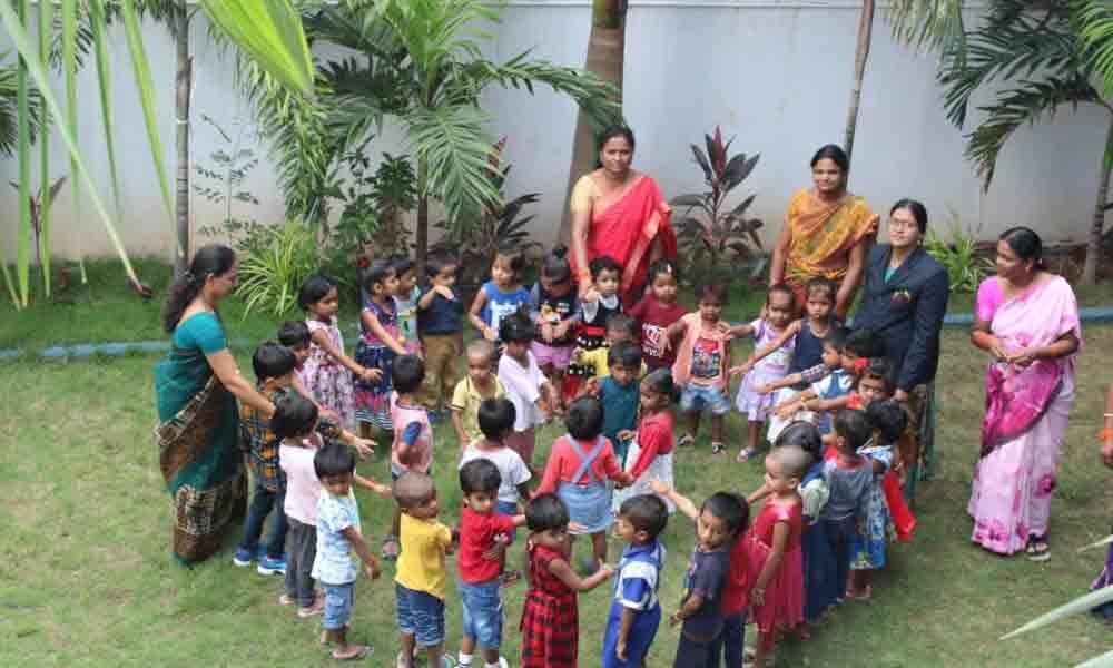 Children tie rakhis to each other in Karimnagar