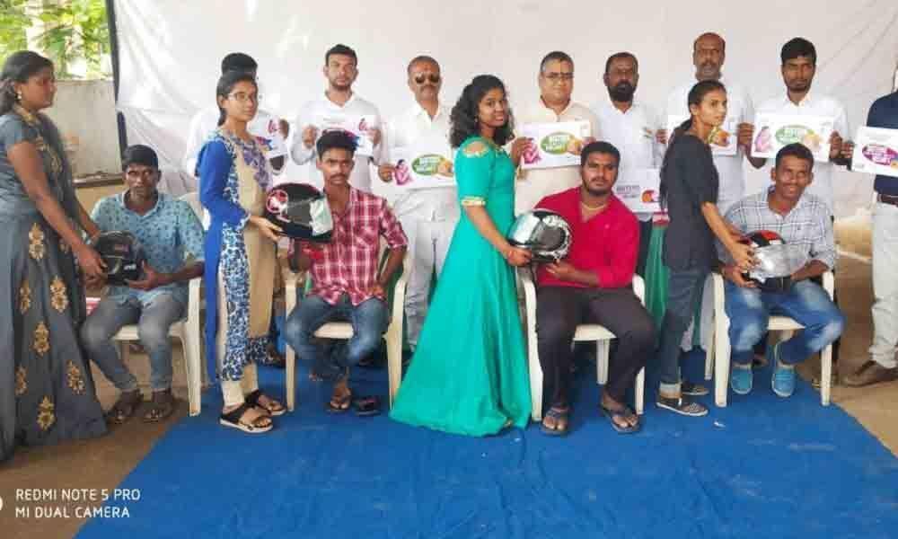 Girls gift helmet for safe journey in Nizamabad