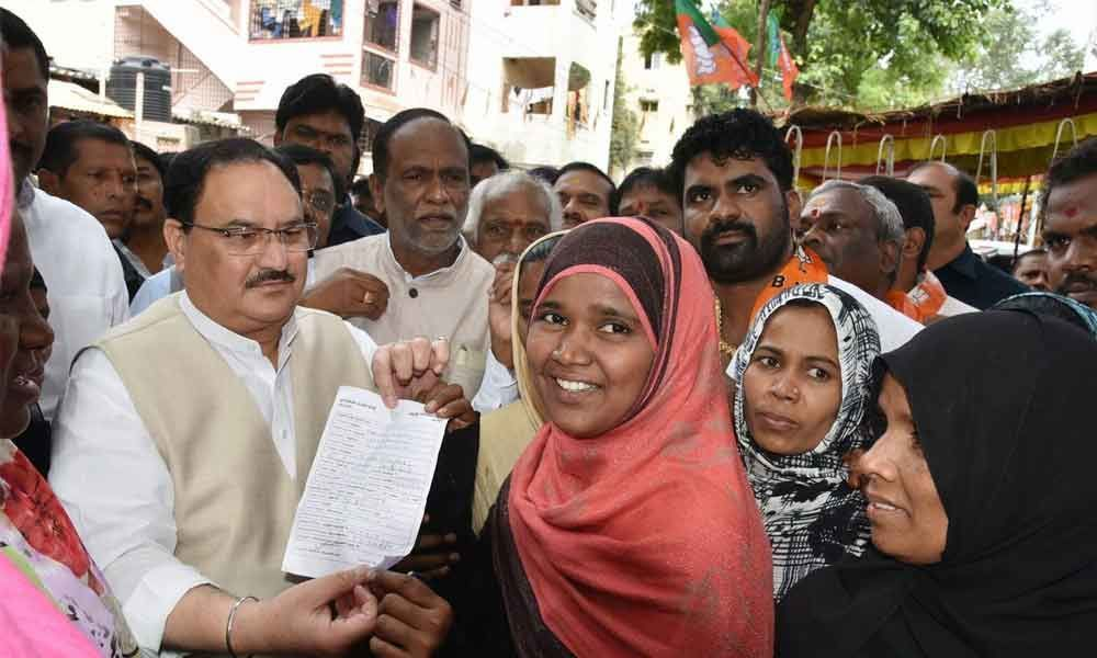 Nadda takes part in door-to-door drive in city