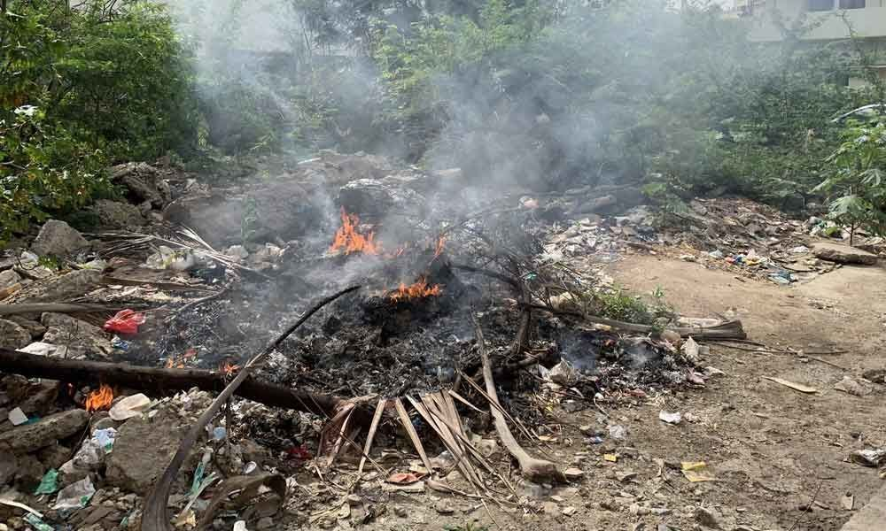 Residents fume over garbage burning