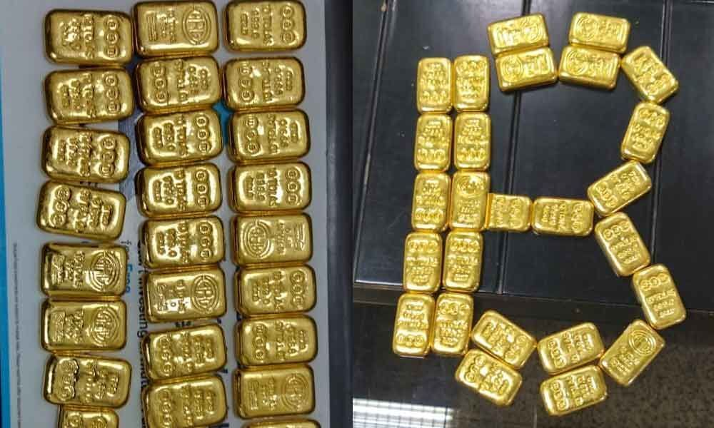 Rs 1.11 Crore smuggled gold bars seized from Sharjah passenger at RGIA, Shamshabad