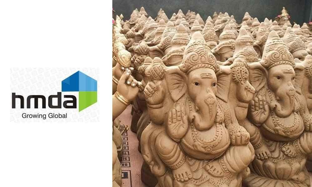 HMDA distributes clay Ganesh idols