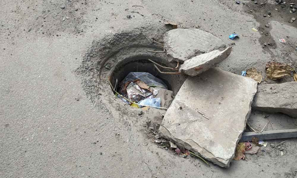 Broken manholes, garbage-filled nalas become curse for residents