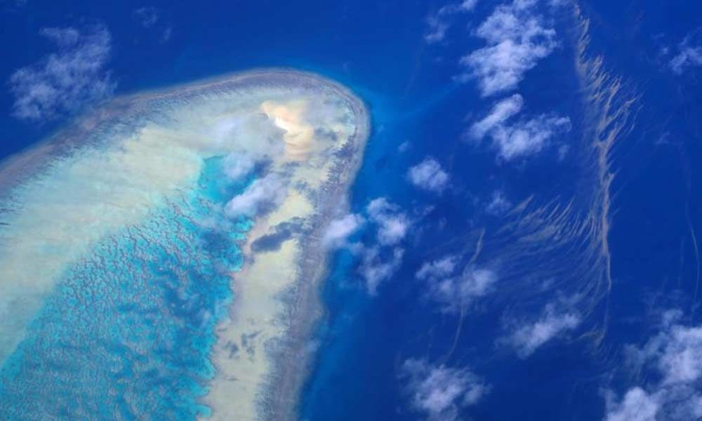 Climate change: Australia downgrades outlook for Great Barrier Reef to