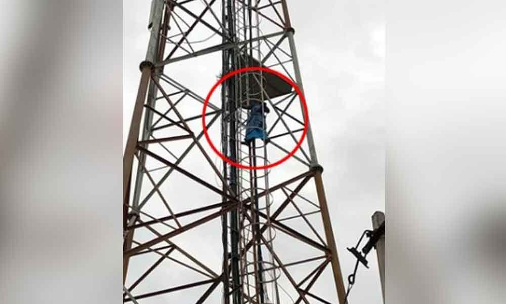 Woman climbs atop cell tower in Nalgonda over property dispute
