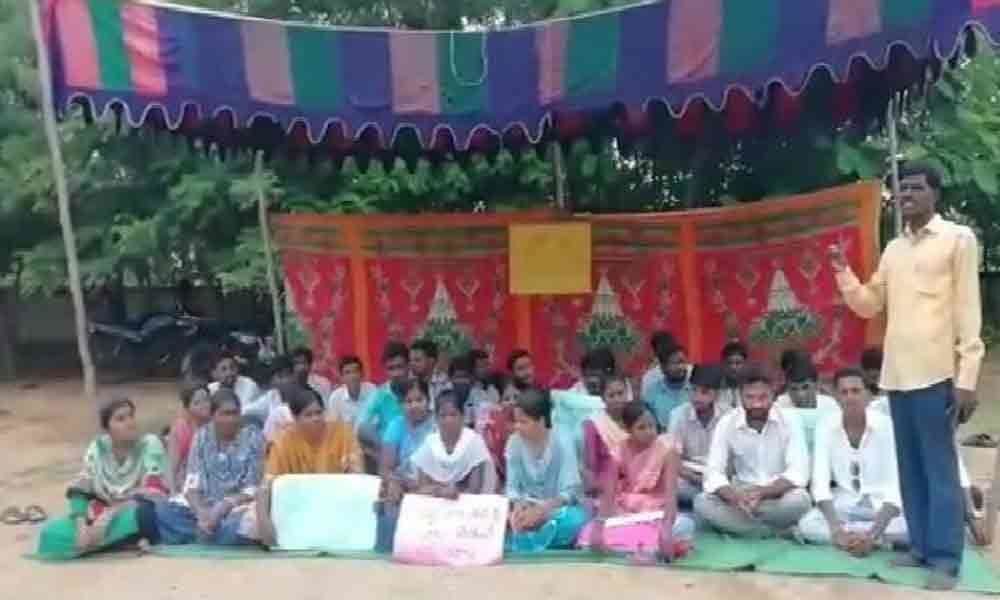Unpaid for 6 months, Vidya Volunteers protest against government