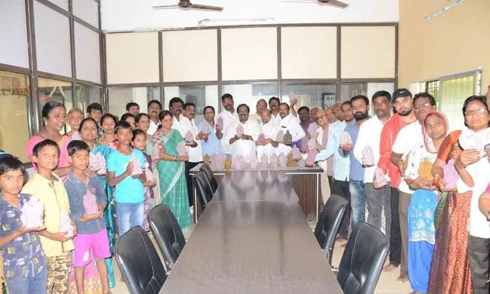 Use clay idols only: Corporator M Srinivas Rao