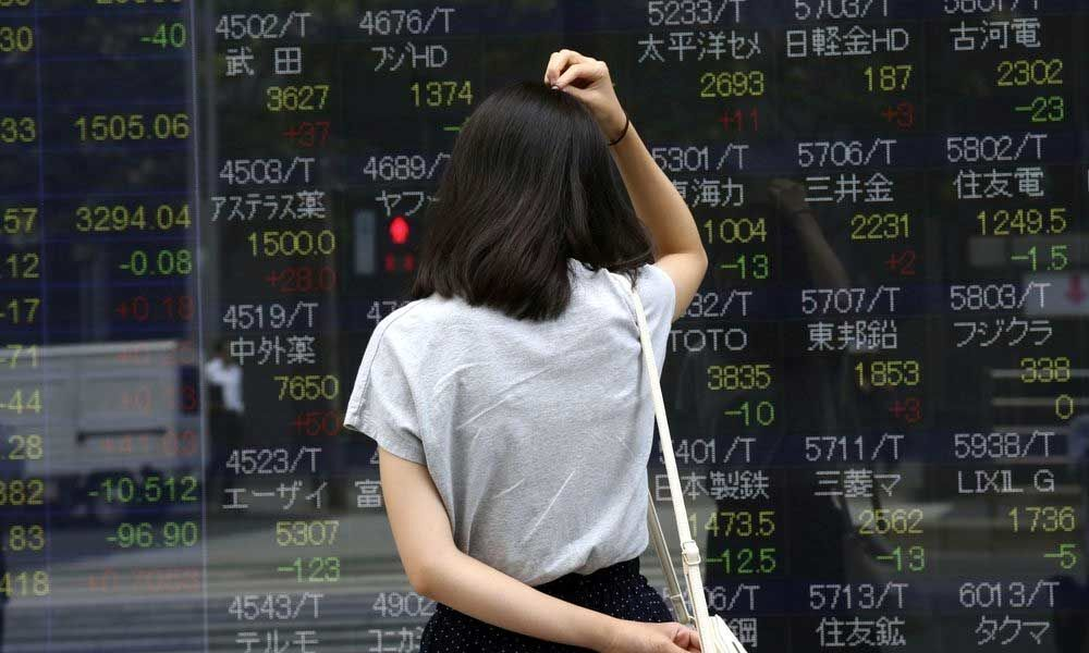 Global stocks mixed after US, China impose new tariff hikes