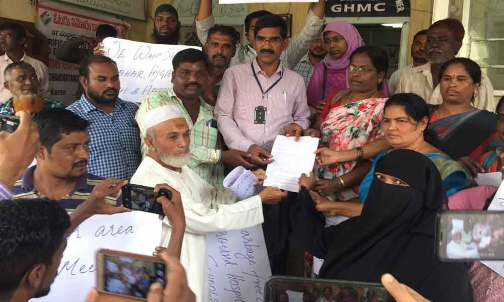 Protests at GHMC office over poor sanitation