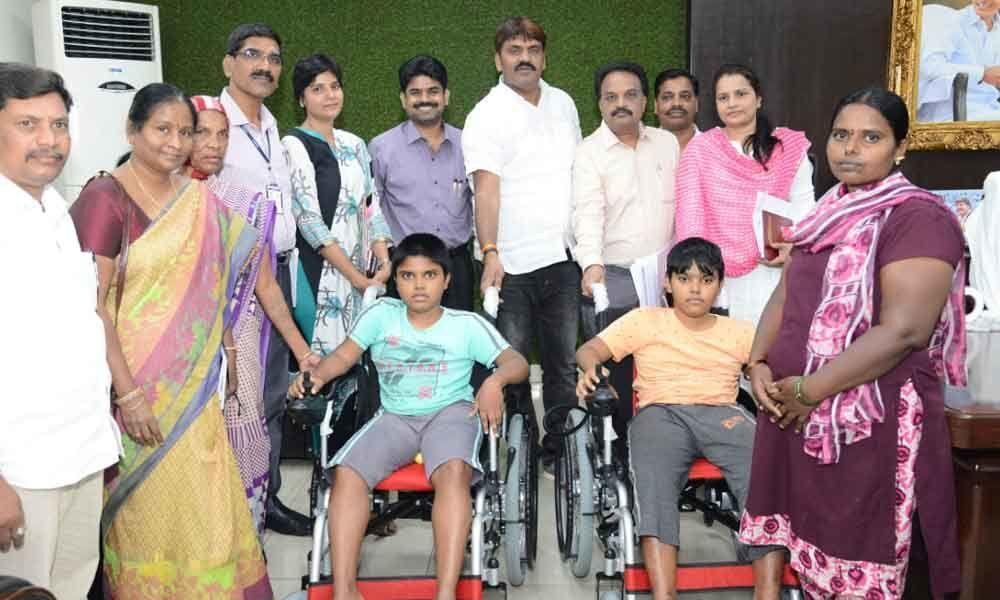 Mayor, wife present wheel-chairs to boys