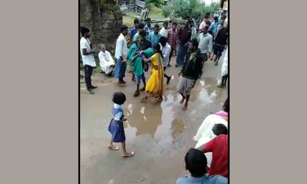 Woman falls sick waiting in queue for urea in Nizamabad