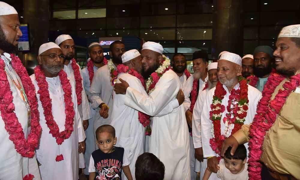 Three batches of Telangana Haj pilgrims return home