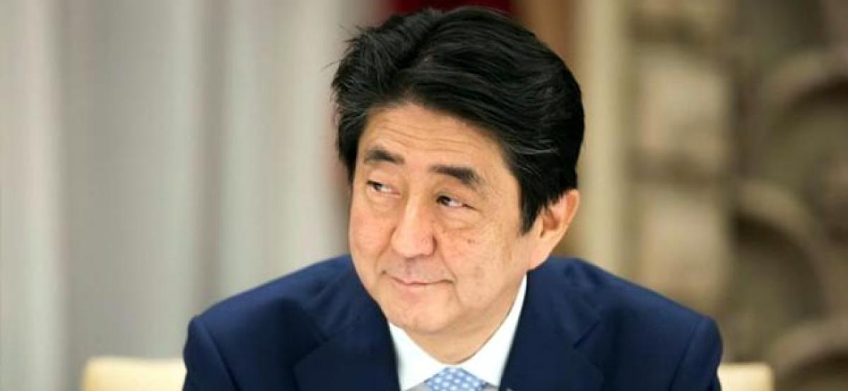 Japan PM Abe battles scandal on two fronts as questions swirl
