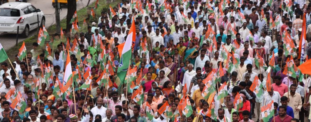 Congress stages dharna at Kothagudem Collectorate: demands pattas for podu lands