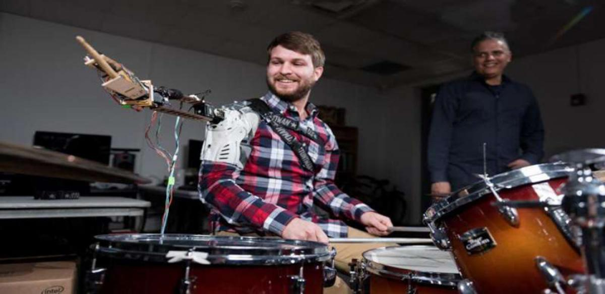 Wearable robot to turn musicians into three armed drummers