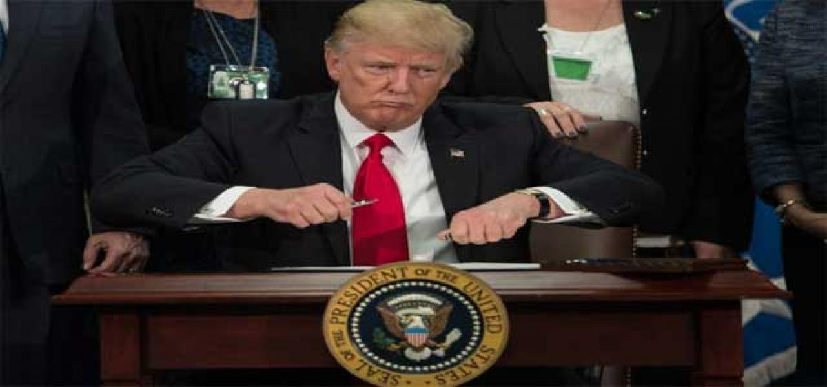Donald Trump signs order to move on Mexico border wall project