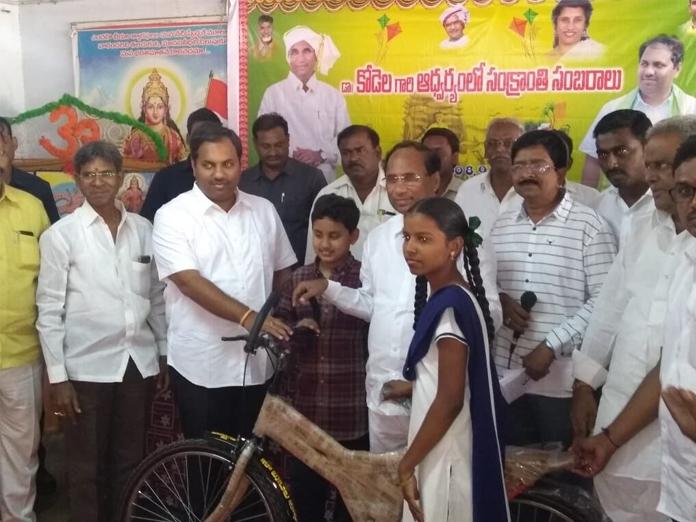 Kodela Siva Prasada Rao distributes bicycles at a programme in Sattenapalli
