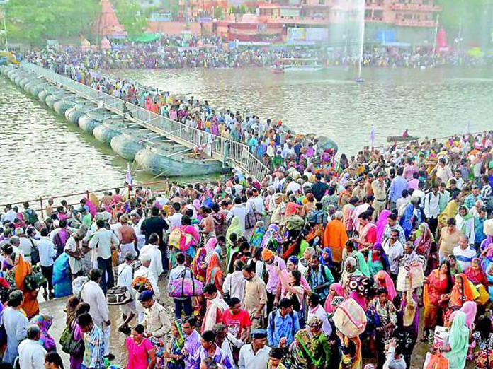 Over 100 million gather for Kumbh mela, devotees to take holy dip today