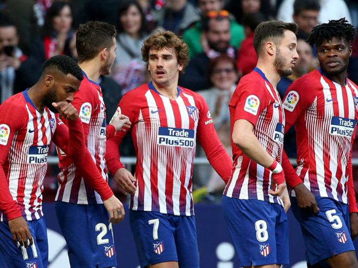 Griezmann, Niguez score as Atletico Madrid maintain pressure on Barcelona