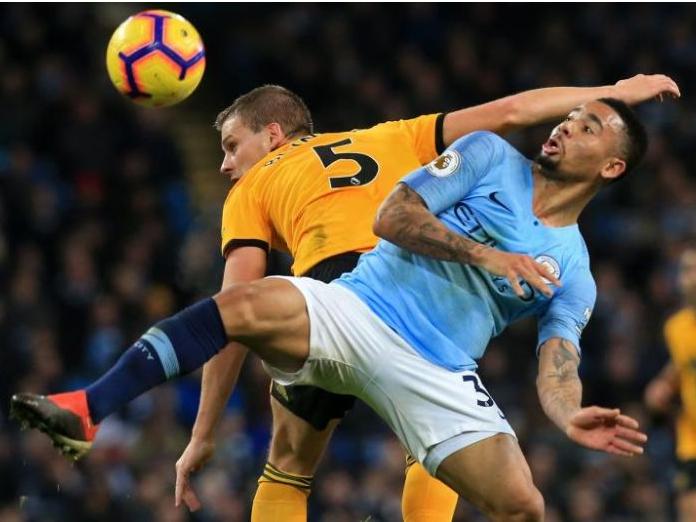 Premier League: Manchester City ease past 10-man Wolves to cut gap at top
