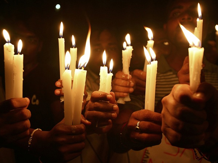 BJP, Congress take out candlelight marches