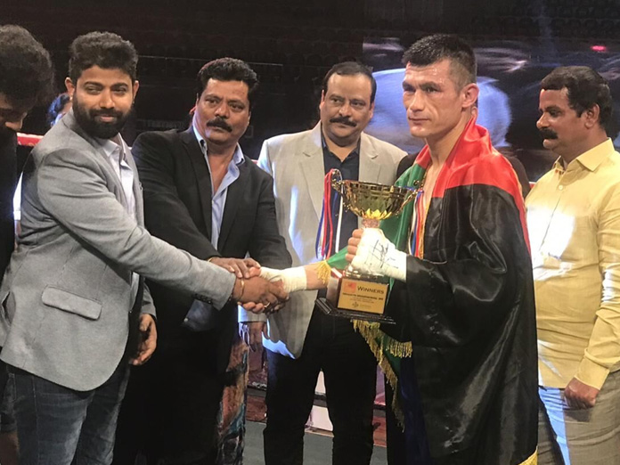 Rahimi outpunches India's Sharma in thrilling bout