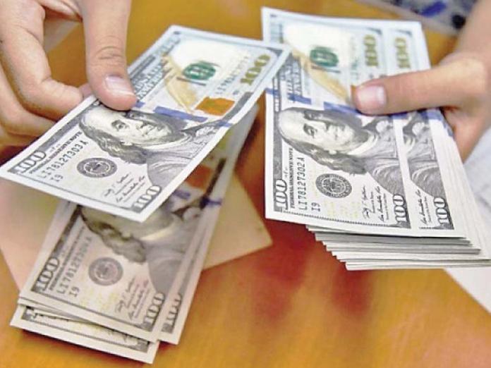 Chinas yuan trades lower against US dollar
