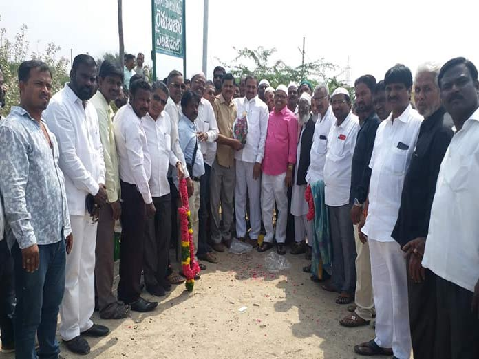 MLA lays stone for graveyard wall