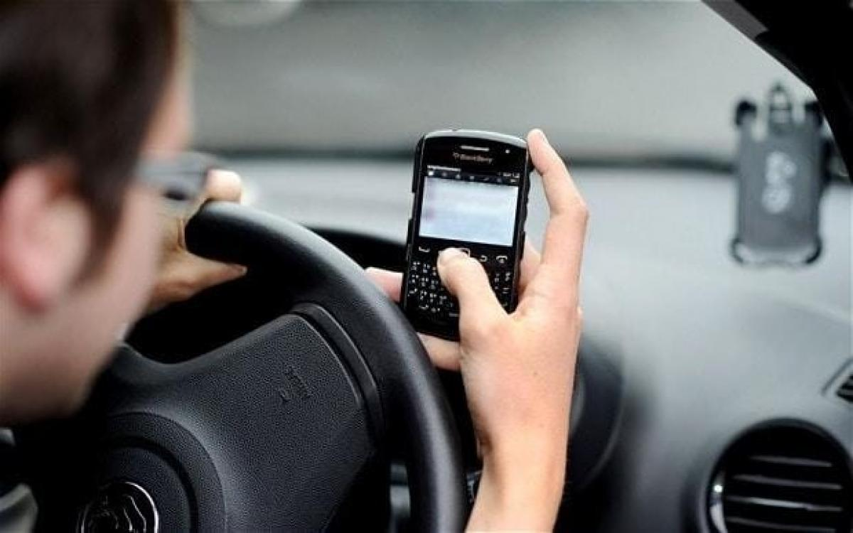 A text may cost UK drivers their licence
