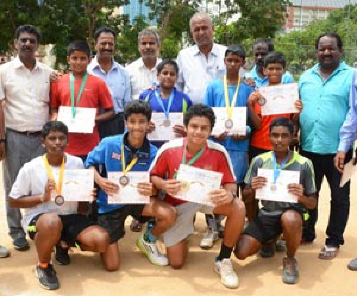 Karthik tops in school tennis