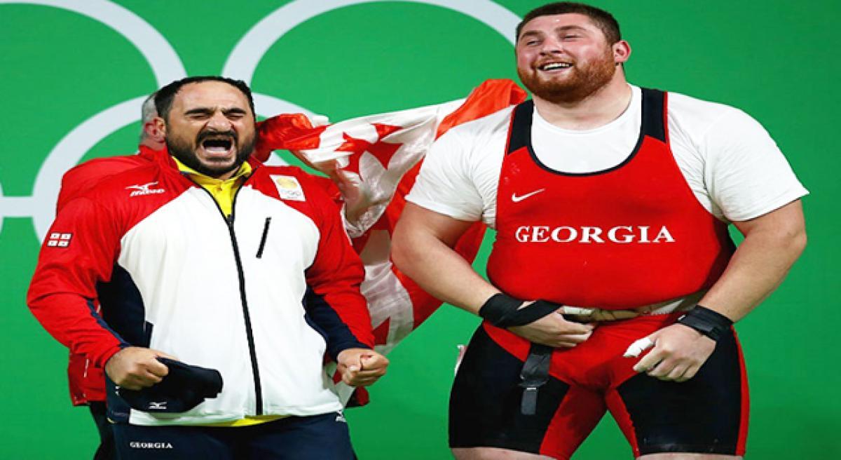 Georgian lifts gold, Iranians cry foul.