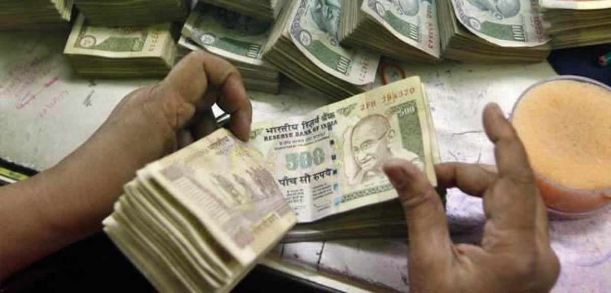 Rupee gains three paise against dollar in early trade