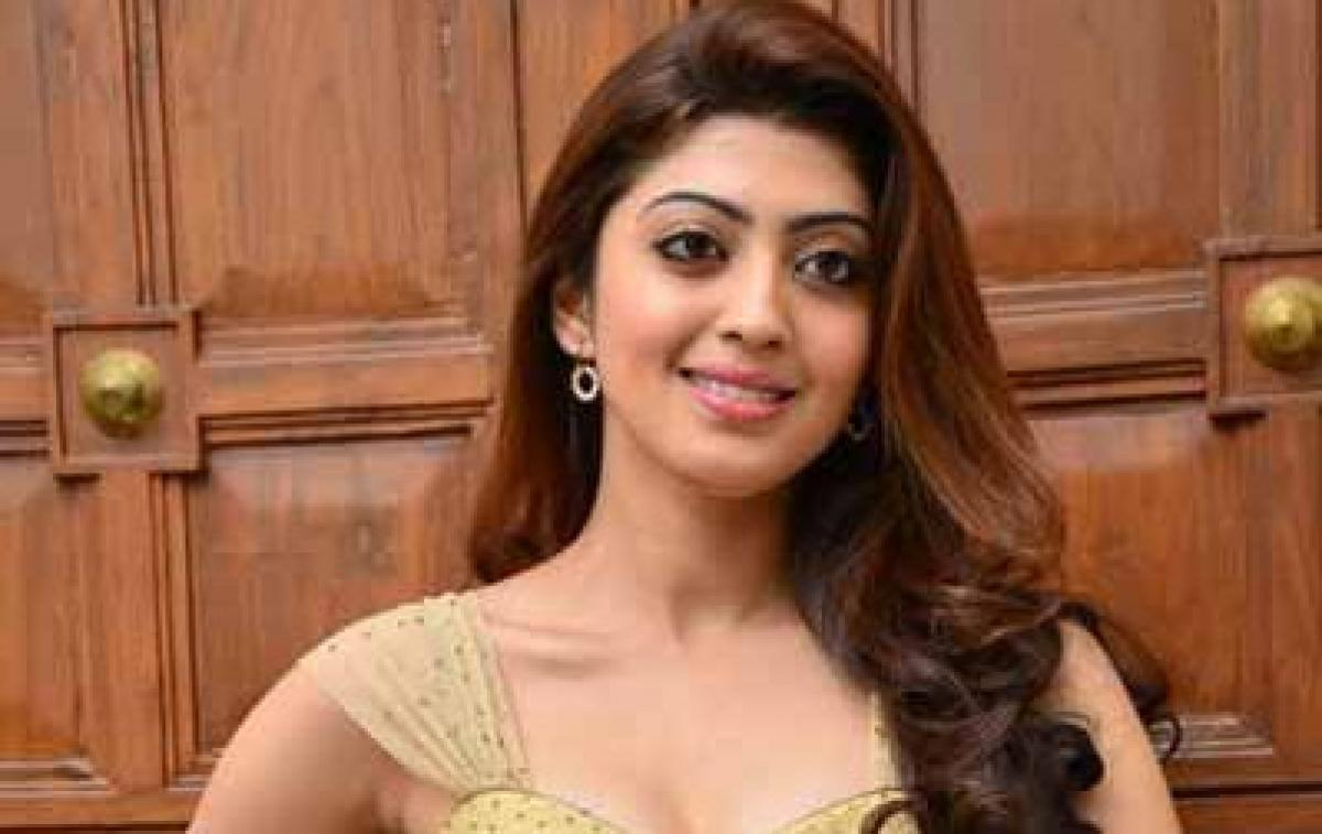 Pranithas car overturns in Khammam, actress escapes with injuries