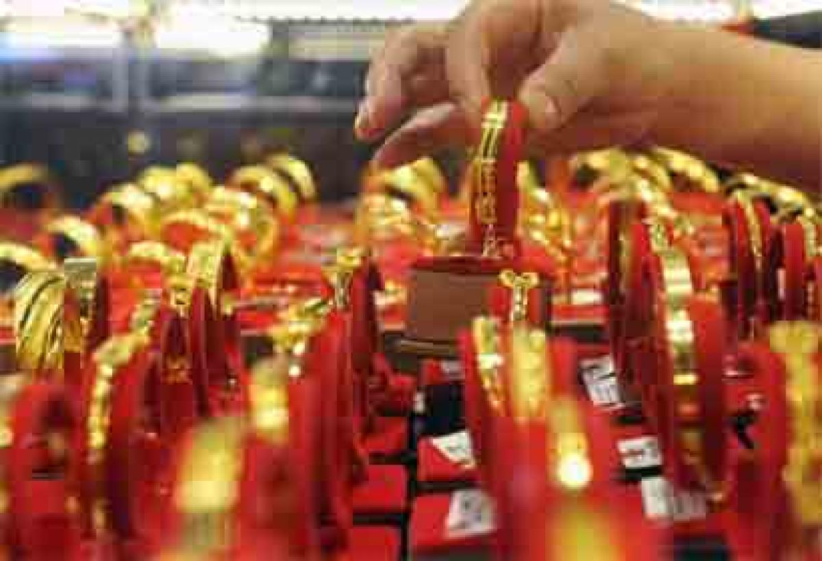 Gold futures up 0.11 per cent on global cues