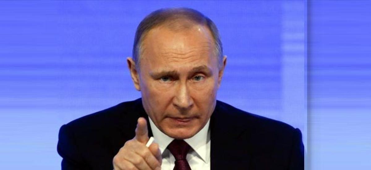 Putin says U.S. Democrats sore losers, praises Trump