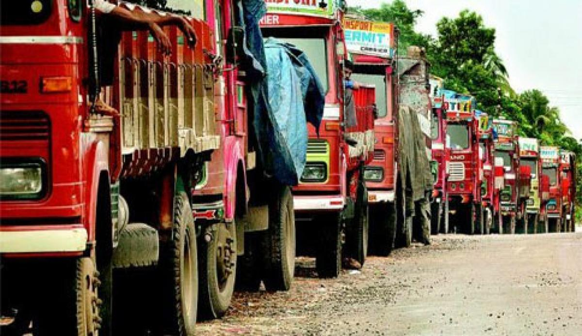 Old trucks emitting dirty air to go off roads in India