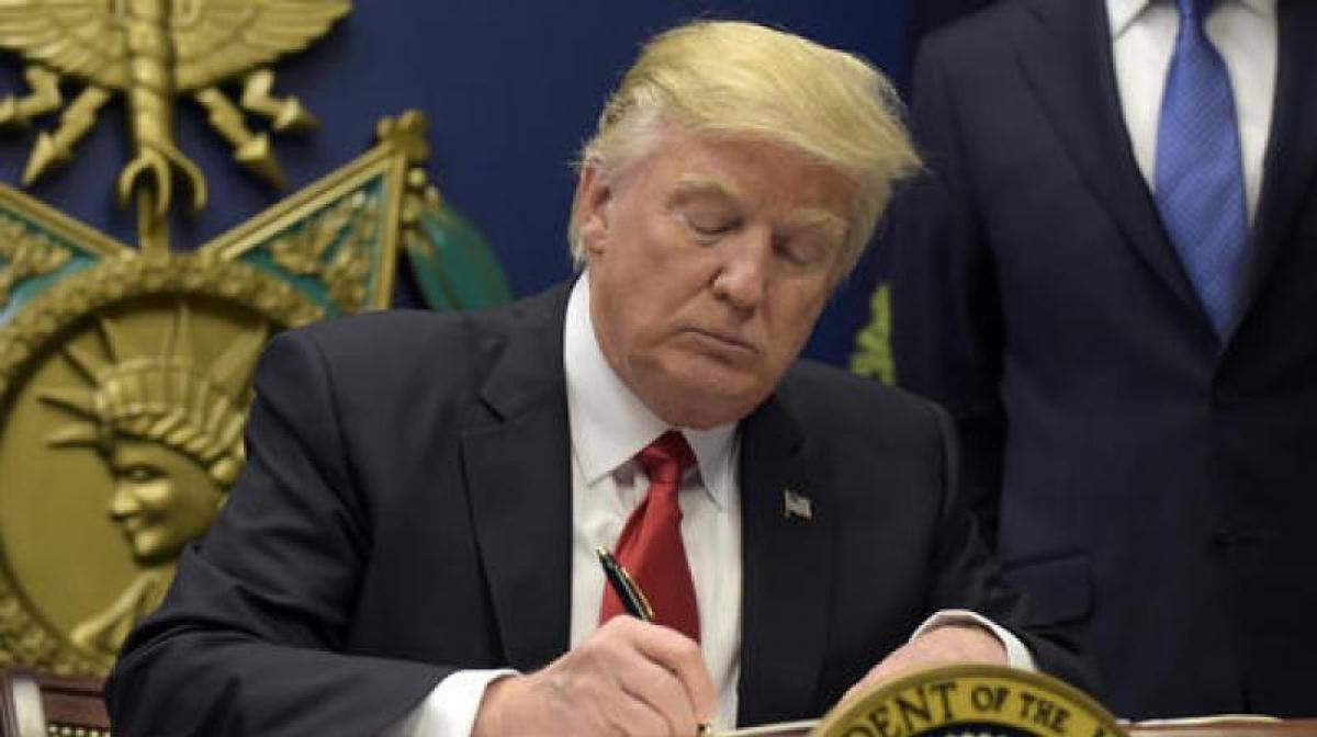 A look at Trumps executive order on refugees, immigration