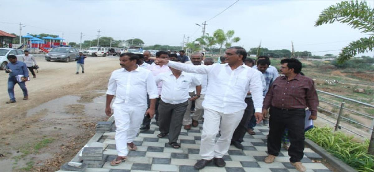 Minister holds review meeting on 2BHK progress