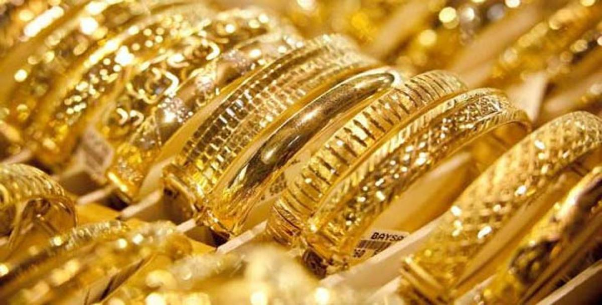 Gold futures weaken 0.08 per cent on global cues